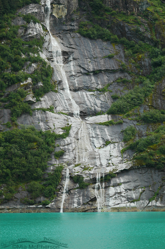 A waterfall and water colored by glacial silt